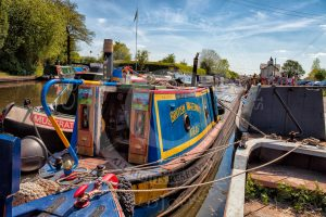 """Ex-British Waterways working boat """"Atlas"""" at the finish of the BCN Marathon Challenge at Longwood Junction on the Daw End Branch."""