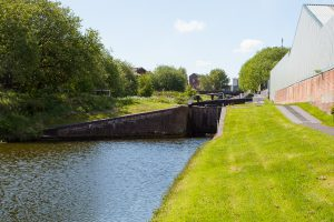 The Titford canal - Lock No. 5 seen from the bottom lock. The six locks have side ponds (gate on the left side) so save water.