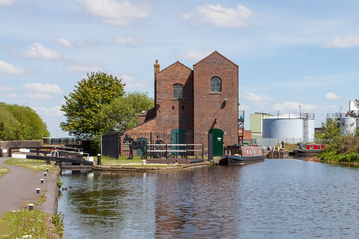 The Titford Canal - Oldbury Top Lock and the Pump House. The narrowboat on the right is moored at the Tat Bank Branch, a feeder to Rotton Park (Edgbaston) reservoir that is navigableonly for a short length.
