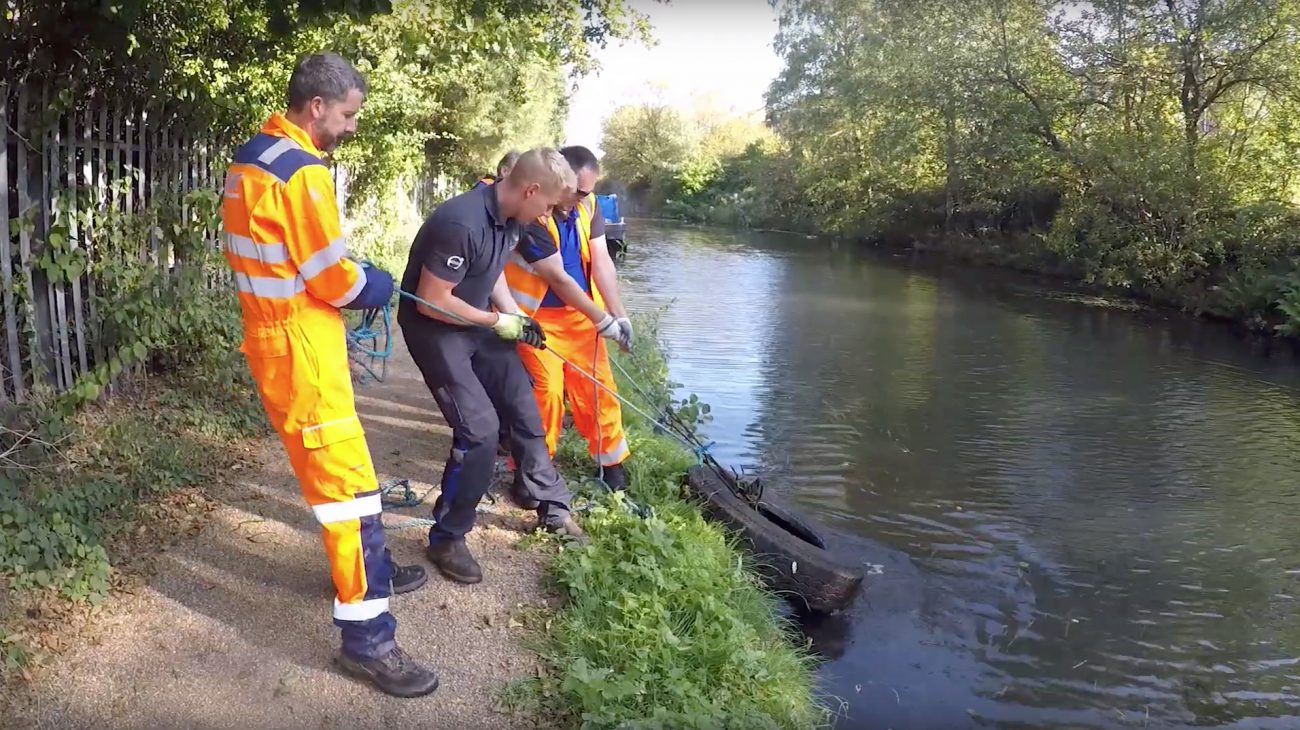 Volunteers pulling a tyre out of the canal during Exec Volunteer Day 2019