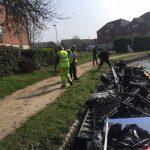 Canal clean-up, work boat full of scrap metal