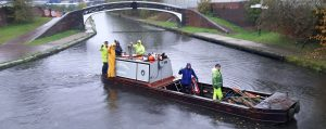 BCNS owned workboat PHOENIX during a canal clean-up