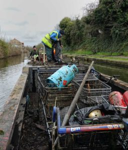 Workboat loaded with scrap metal from the canal on the BCN Cleanup Weekend 2020